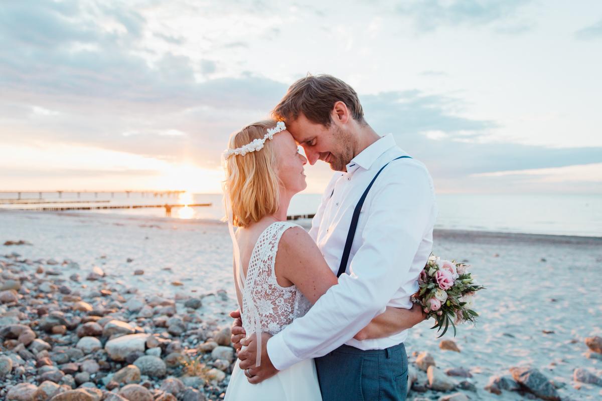 Sonnenuntergangs-Hochzeitsfotografie.